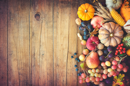 Vegetables pumpkins and fruits in autumn thanksgiving still life on wooden table Stock Photo