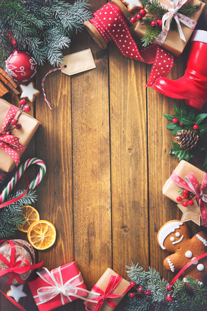 Christmas vintage presents on a wooden background. Top view