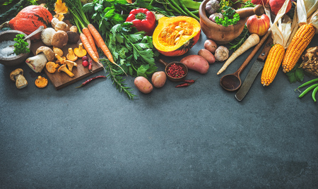 Traditional autumn vegetables ingredients for tasty Thanksgiving or Christmas dishes on rustic kitchen table. Top view