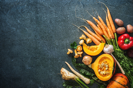 Traditional autumn vegetables ingredients for tasty Thanksgining or Christmas dishes on rustic kitchen table. Top view