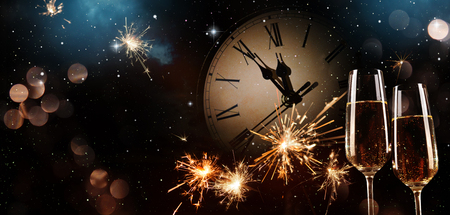 New Years Eve celebration background. Toast with fireworks and champagne at midnight Stock Photo