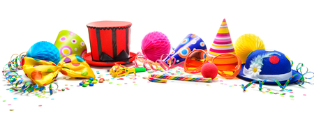 Colorful birthday or carnival background with party items isolated on white. Festivity concept
