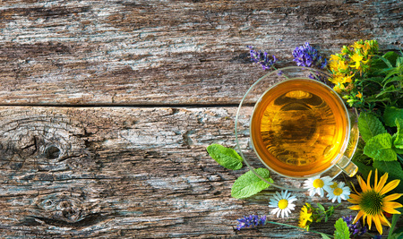 Cup of herbal tea on wooden table Standard-Bild