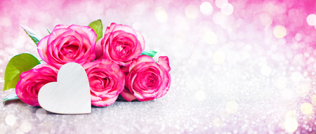 Romantic background with bouquet of pink roses and heart for Valentines day and other holidays