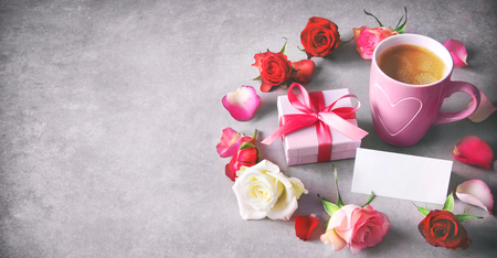 Valentines Day, Mothers Day, Happy Birthday. Holidays background with coffee mug, gift box, colorful roses and message