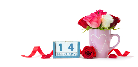 Valentines Day background. Calendar date,   mug with bouquet of roses and hearts