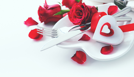 Romantic table setting on white table. Valentines day card template