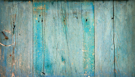 Rustic weathered old painted wood background with knots and nail holes Imagens