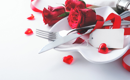 Romantic table setting on white table. Valentine's day card template 스톡 콘텐츠