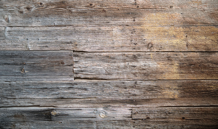 Rustic weathered wood background with knots and nail holes