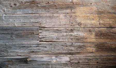 Rustieke verweerde houten achtergrond met knopen en spijkergaten Stockfoto