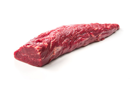 Fresh and raw beef meat. Whole piece of tenderloin ready to cook isolated on white background