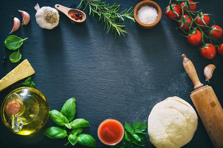 Top view of ingredients for cooking pizza or pasta. Mediterranean healthy cuisine Standard-Bild
