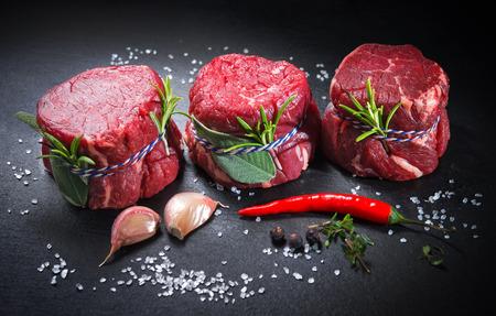 Raw beef fillet steaks mignon with spices on dark background Zdjęcie Seryjne - 96090113