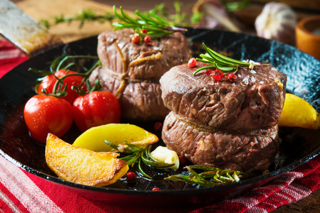 Beef steak. Juicy medium beef fillet steaks mignon in pan on table Stock Photo