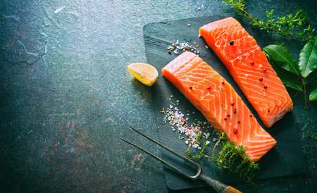 Fresh salmon fillet steaks with aromatic herbs, spices and vegetables. Balanced diet or cooking concept Stock fotó - 96072343