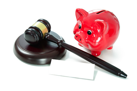 Judges court gavel and piggy bank with an empty tag for your text. Isolated on white background Foto de archivo