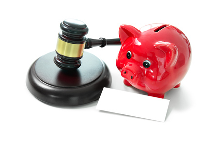 Judges court gavel and piggy bank with an empty tag for your text. Isolated on white background Stock Photo