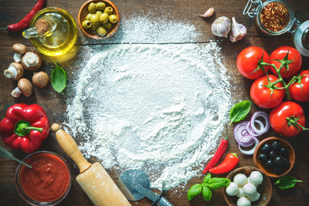 Ingredients and spices for making homemade pizza. Top view with copy space on wooden table Reklamní fotografie - 96255013