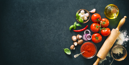 Delicious pizza with ingredients and spices. Top view with copy space on wooden table Stockfoto