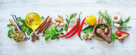 Fresh aromatic herbs and spices for cooking on wooden board