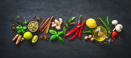 Fresh aromatic herbs and spices for cooking on dark background Stock Photo