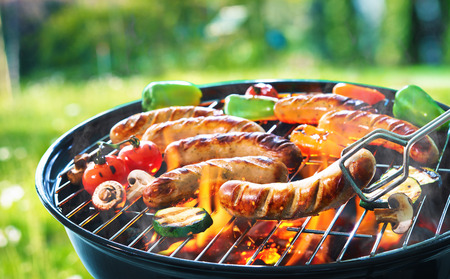 Grilled sausage on the picnic flaming grill  Stock Photo