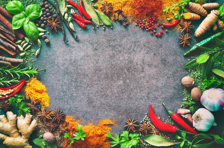 Various herbs and spices on stone background