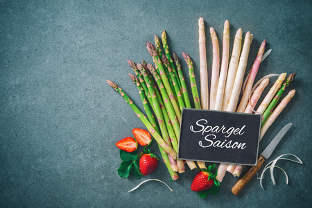Green and white fresh asparagus with strawberries Stock Photo