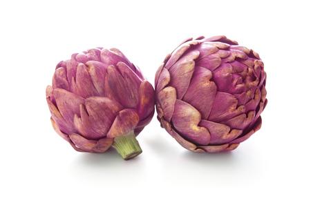 Purple artichokes. Isolated on white background Stock Photo