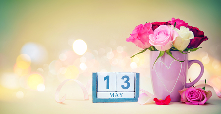 Mothers Day background with calendar date, mug, bouquet of roses and hearts