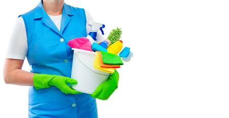 Female cleaner holding a bucket with cleaning supplies isolated on white background Stock Photo