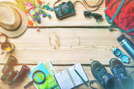 Travel planning and preparation for holidays trip, accessories on vintage wooden table Stock Photo