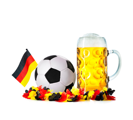 Glass with beer, soccer ball with german flag and flower chain isolated on a white background