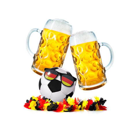 Two glasses with beer and soccer ball with german fan sunglasses and flower chain isolated on a white background