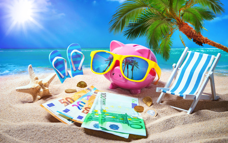 Piggy bank with sunglasses relax on the beach holiday. Travel money savings concept, summer vacation