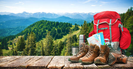 Big backpack and trekking boots in mountains Stock Photo