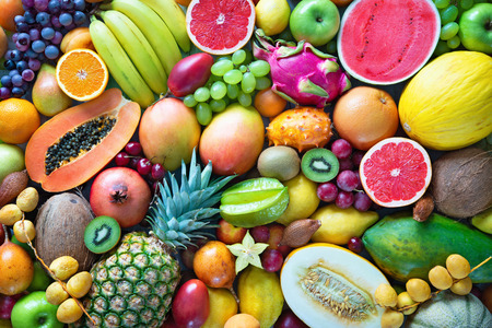 Food background. Assortment of colorful ripe tropical fruits. Top view