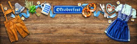 Rustic background for Oktoberfest with white and blue fabric, Bavarian clothes, gingerbread, beer stein and pretzel Zdjęcie Seryjne - 105721111