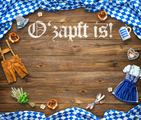 Rustic background for Oktoberfest with white and blue fabric, Bavarian clothes, gingerbread, beer stein and pretzel Banco de Imagens - 105721142