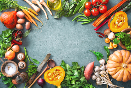 Healthy or vegetarian nutrition concept with selection of organic autumn fruits and vegetables on rustic wooden table Stock Photo - 106299587