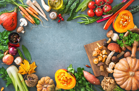 Healthy or vegetarian nutrition concept with selection of organic autumn fruits and vegetables on rustic wooden table Stock Photo - 106299593