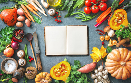 Healthy or vegetarian nutrition concept with selection of organic autumn fruits and vegetables on rustic wooden table Stock Photo - 106299596