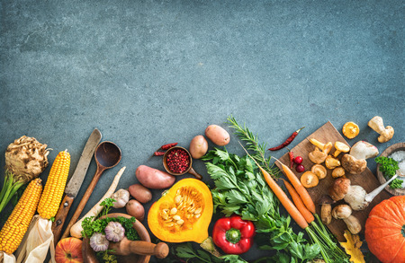 Healthy or vegetarian nutrition concept with selection of organic autumn fruits and vegetables on rustic wooden table