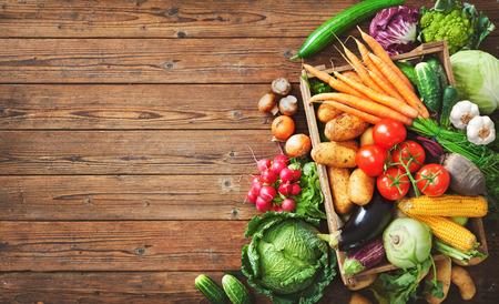Assortment of fresh vegetables on wooden background Foto de archivo - 108473316