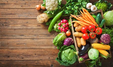 Assortment of fresh vegetables on wooden background Foto de archivo - 108473322