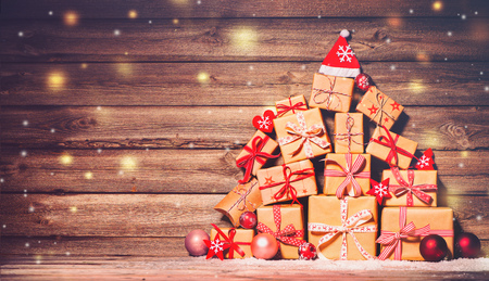 Christmas background with decorations and gift boxes on wooden board Foto de archivo - 108473324