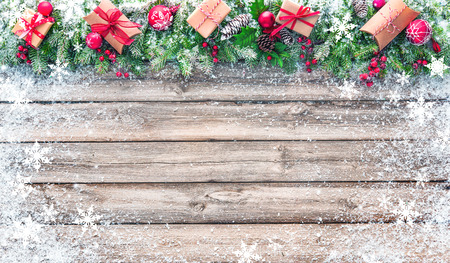 Christmas background with decorations and gift boxes on wooden board Foto de archivo - 108582656