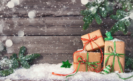 Christmas background with decorations and gift boxes on wooden board Foto de archivo - 111448518
