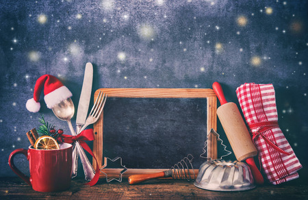 Rustic background for Christmas baking or cooking with kitchen utensils Foto de archivo - 112560193